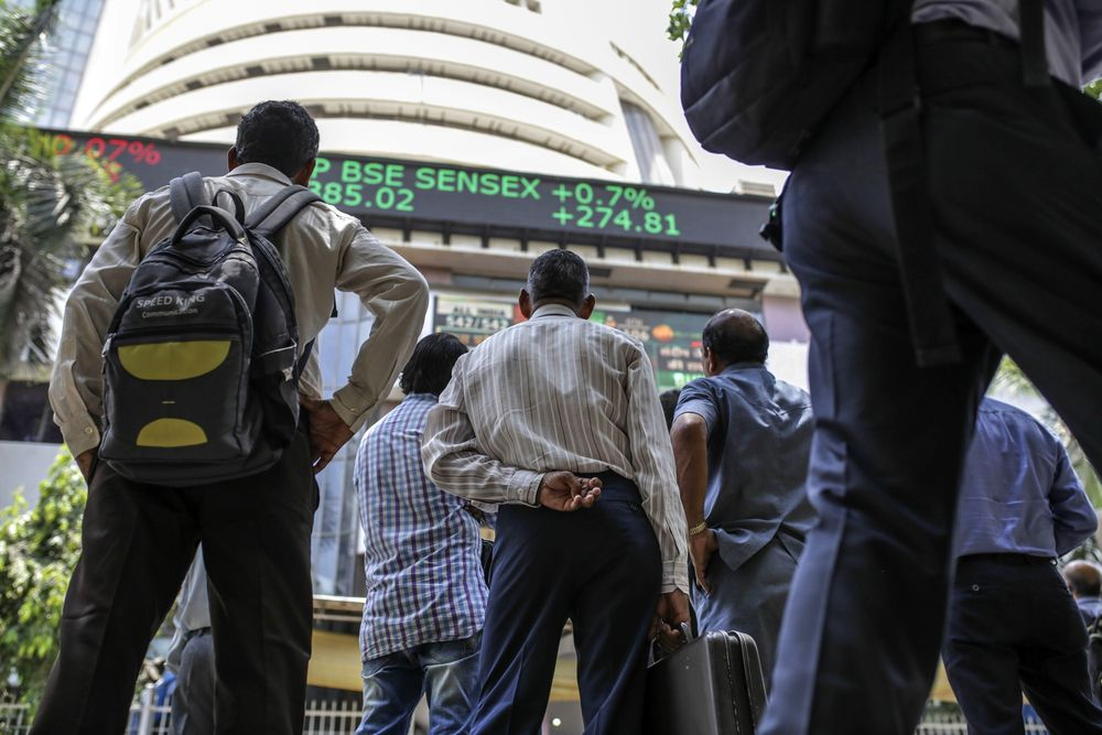 People watching the BSE Sensex Index in Dalal Street Mumbai